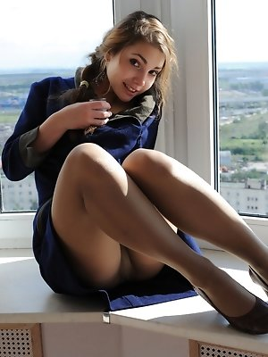 Playful and youthful Mila H stripping by the window.